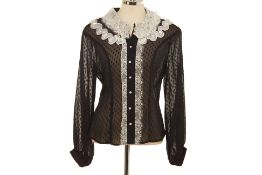 A LIME SHEER BLACK BLOUSE WITH WHITE LACE DETAILS