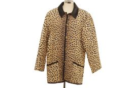 A CHRISTIAN DIOR BOUTIQUE VINTAGE CHEETAH PRINT QUILTED COAT