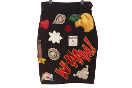 "A MOSCHINO BLACK ""WHAM"" PATCH SKIRT"