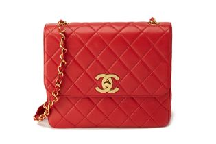 A VINTAGE CHANEL QUILTED RED LAMBSKIN FLAP BAG