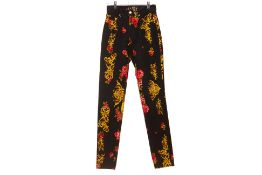 A PAIR OF MCM BAROQUE & FLORAL PRINTED JEANS