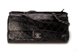 A CHANEL QUILTED BLACK PATENT RITZ FLAP BAG