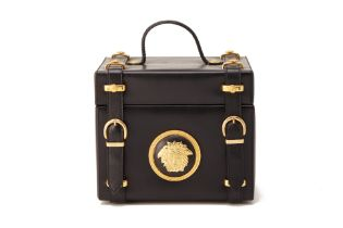 A GIANNI VERSACE BLACK LEATHER VANITY CASE