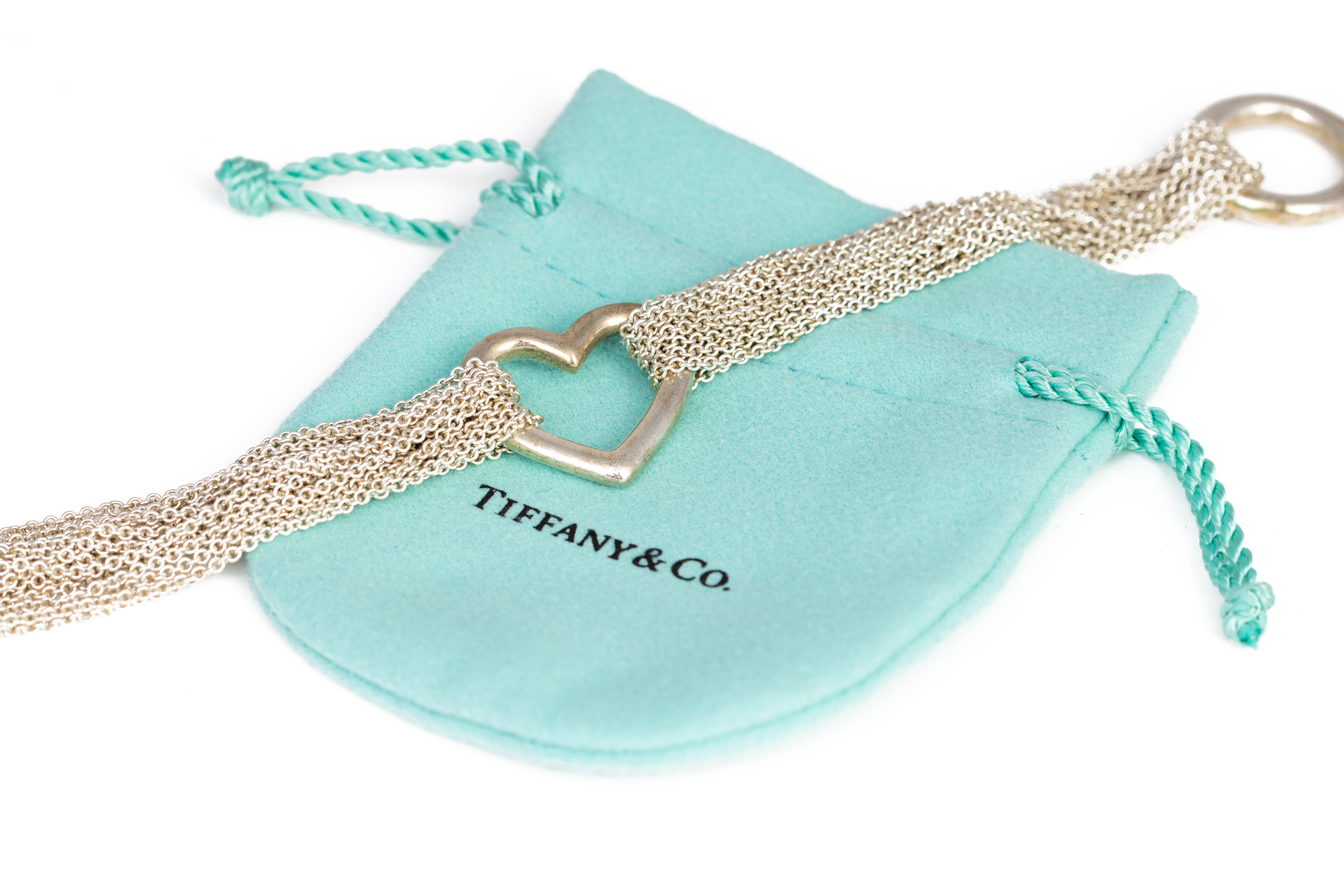 A TIFFANY & CO. SILVER TEN ROW CHAIN HEART TOGGLE BRACELET - Image 4 of 4