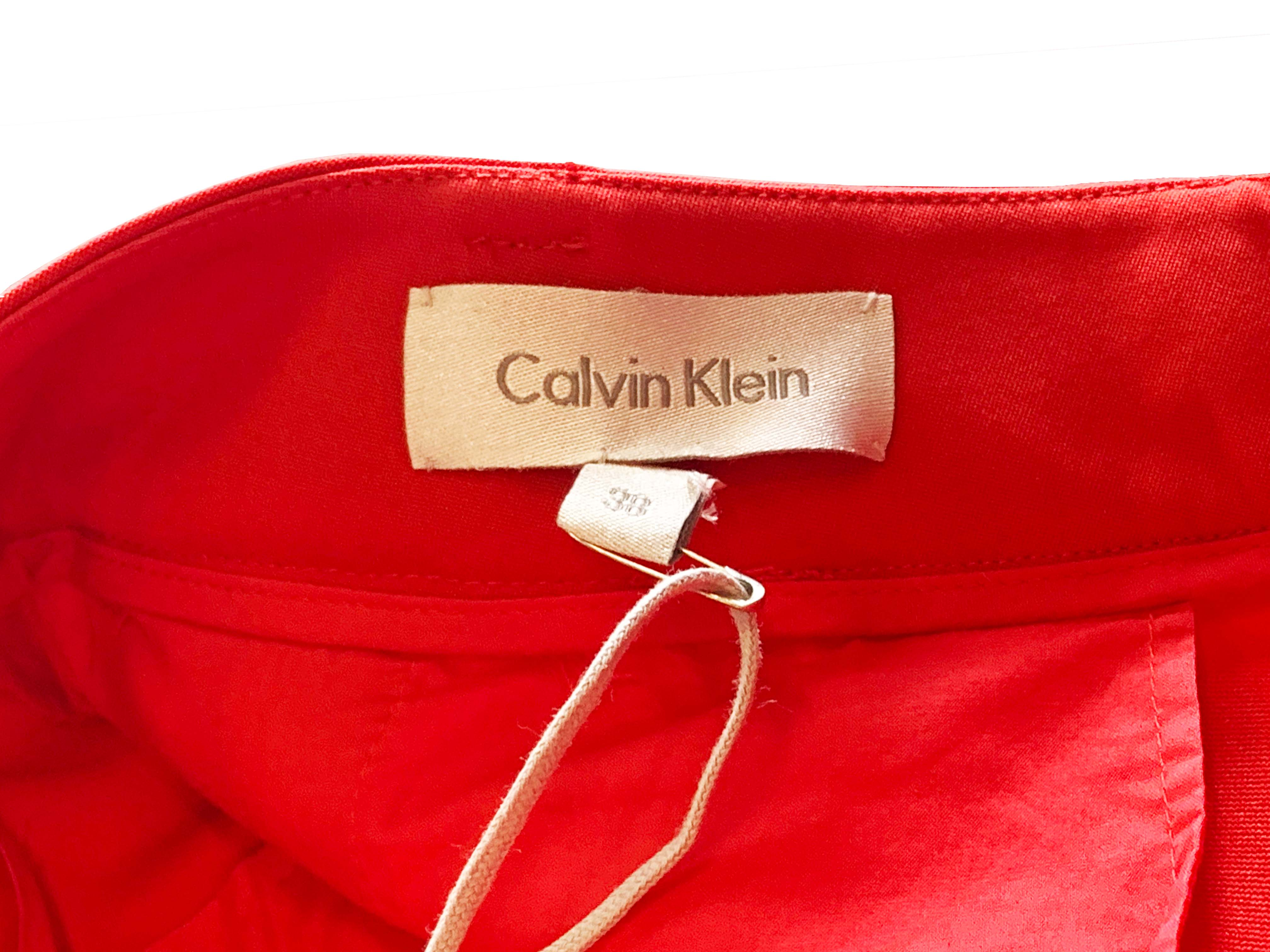 A PAIR OF CALVIN KLEIN RED TROUSERS - Image 3 of 3