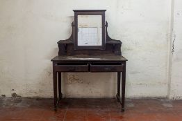 A MIRROR BACK DRESSING TABLE