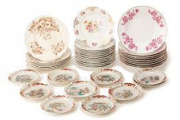 A GROUP OF PORCELAIN PLATES AND SPOONS