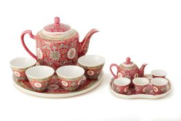 TWO SIMILAR CHINESE PINK GROUND TEA SERVICES