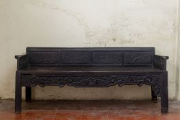 A PAIR OF CARVED BLACKWOOD BENCHES