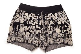 A PAIR OF CHANEL FLORAL KNITTED SHORTS