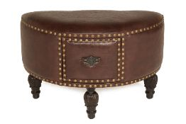 A LEATHER UPHOLSTERED STOOL
