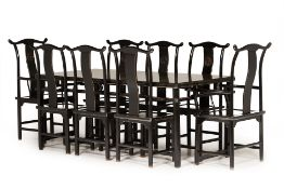 A CHINESE BLACK LACQUER DINING TABLE AND CHAIRS