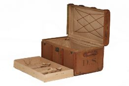 A CANVAS AND WOOD BOUND STEAMER TRUNK