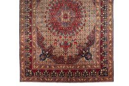 A LARGE PERSIAN MOUD CARPET