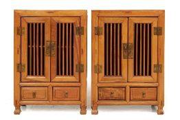 A PAIR OF CHINESE ELM BEDSIDE CABINETS