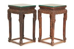 A PAIR OF CHINESE CARVED BLACKWOOD STANDS