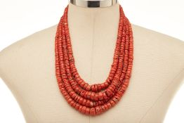 A FOUR STRAND CORAL BEAD NECKLACE