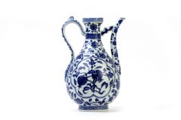 A CHINESE BLUE AND WHITE PORCELAIN POMEGRANATE EWER