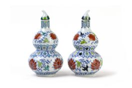 A NEAR PAIR OF DOUBLE-GOURD DOUCAI VASES AND COVERS
