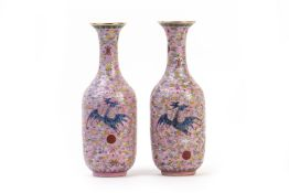 A PAIR OF PINK GROUND FAMILLE ROSE PORCELAIN VASES
