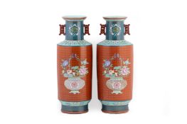 A PAIR OF TWIN HANDLED CORAL GROUND FAMILLE ROSE VASES