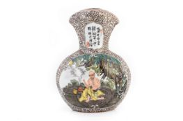 A CHINESE FLATTENED BALUSTER VASE WITH SCHOLARS