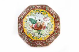 AN OCTAGONAL FAMILLE ROSE PORCELAIN BOX AND COVER