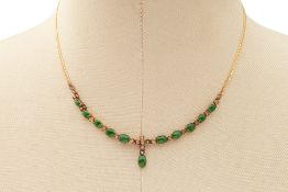 A JADE CABOCHON AND DIAMOND NECKLACE