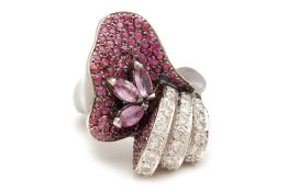 A RUBY AND DIAMOND PAVE FLORAL RING