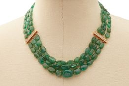 A TUMBLED EMERALD AND DIAMOND BEADED NECKLACE