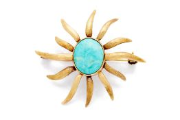 A GOLD AND TURQUOISE SUN SHAPED BROOCH