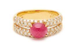 A CABOCHON RUBY AND DIAMOND RING