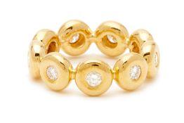 A YELLOW GOLD AND DIAMOND BEZEL SET RING