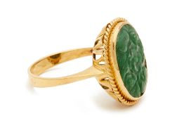A CARVED JADE RING