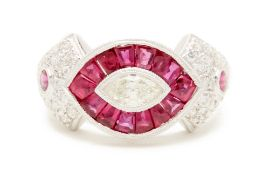 A PLATINUM, RUBY AND DIAMOND RING