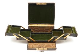 AN ANTIQUE EXPANDING JEWELLERY BOX