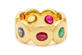 A EMERALD, RUBY, YELLOW AND BLUE SAPPHIRE ETERNITY RING