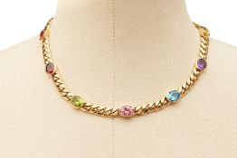A 18K YELLOW GOLD AND GEMSTONE CHAIN
