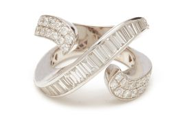 A LARGE WHITE GOLD RING WITH DIAMOND EMBELLISHMENTS