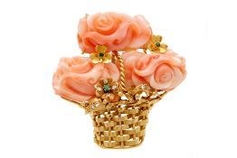 A CORAL & GOLD FLOWER BROOCH