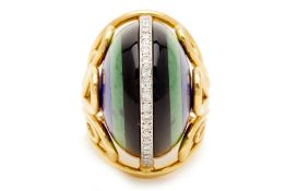 AN ART DECO STYLE DOMED RING