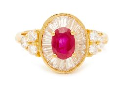 AN OVAL RUBY AND DIAMOND RING