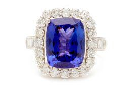 A PLATINUM, TANZANITE AND DIAMOND RING