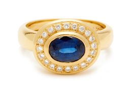 A 18K SAPPHIRE AND DIAMOND RING