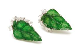A PAIR OF CARVED EGGSHELL JADE AND DIAMOND EARRINGS