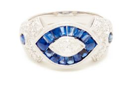 A PLATINUM, SAPPHIRE AND MARQUISE DIAMOND RING