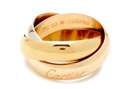 A CARTIER WHITE, YELLOW AND ROSE GOLD TRINITY RING