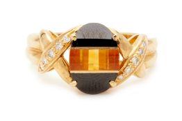 AN ONYX, CITRINE AND DIAMOND RING