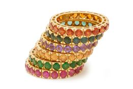 A SET OF SIX GEM STACKING FULL ETERNITY RINGS