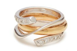 A WRAP-AROUND YELLOW AND WHITE METAL RING